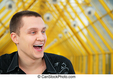 laughing young man in black shirt