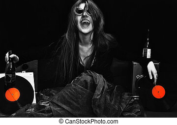 laughing young woman in sunglasses. rock style