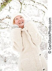 Laughing young woman in the snow