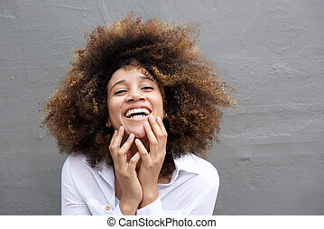Laughing young woman with afro hair
