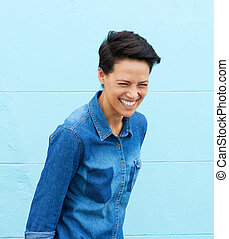 Laughing young woman with short hair