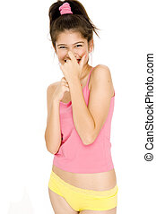 Laughter - A pretty young woman covers her laugh