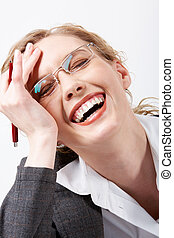 Laughter - Image of happy woman in eyeglasses touching her...