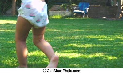 Laughting girl running on backyard in slow motion - Happy...