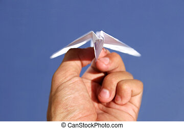 Launch - Paper plane in the process of being launched