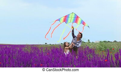 Launching a kite in a field