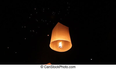 launching fire lantern - people launching traditional fire...