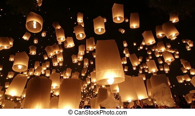 Launching flying lanterns - Thousands of flying lanterns...