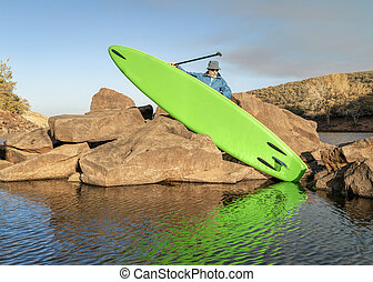 launching inflatable stand up paddleboard