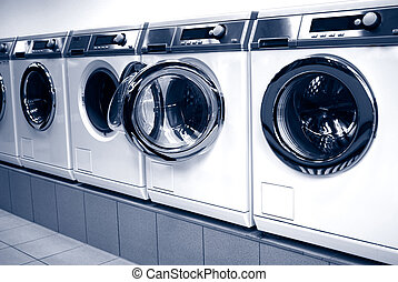 washing machines in arow in a laundry
