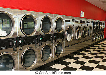 Laundromat Dryers - A row of dryers line the wall of a ...
