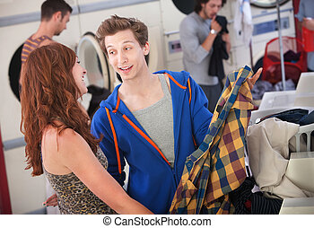 Laundromat Flirt - Young handsome Caucasian man flirts with...