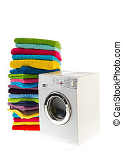 Laundromat with laundry - Laundromat with pile of colorful ...
