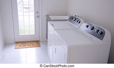 laundry. A washing and dryer machine at home - A washing and...