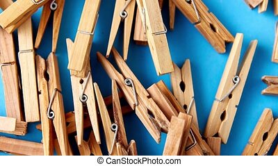 laundry and eco living concept - close up of wooden clothespins on blue background
