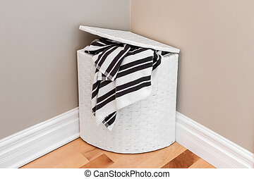 Laundry basket in the room corner