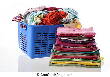 Laundry - Basket of dirty and heap of clean clothes