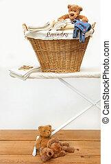 Laundry basket with teddy bears on floor