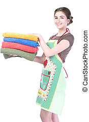 Bright picture of lovely housewife with towels. Isolated on white background