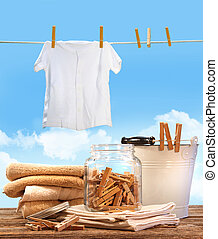 Laundry day with towels, clothespins on table