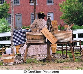 Woman washing cloths at Civil War reenactment camp