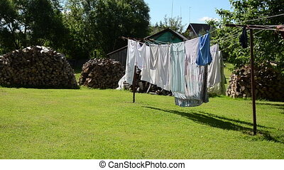 laundry dry firewood - laundry hang dry on outdoor rope move...