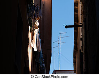 Laundry hanging in a street in Venice on a sunny day in winter