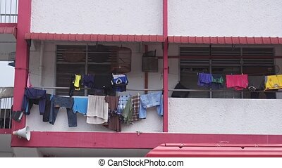 Laundry Hanging to Dry in front of Penang Home. FullHD 1080p...