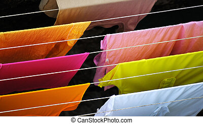 Laundry - Image shows colorful clothes hanged for drying ...
