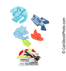 Laundry in a basket and falling clothes - isolated on a white background