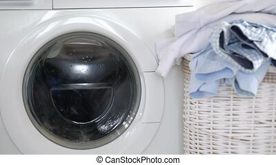 Laundry is washed in the washing machine, and clean things...