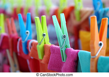 Laundry Pins - Close-up of colorful laundry pins and hanged...