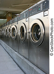 Public laundry machines standing in a row