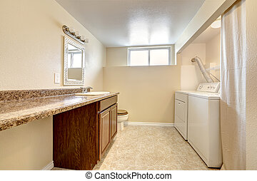 Laundry room with granite counter top and cabinet - Bright...