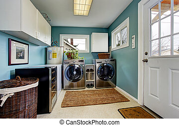 Laundry room with modern steel appliances - Light blue ...