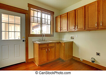 Laundry room with sink. New luxury home interior.