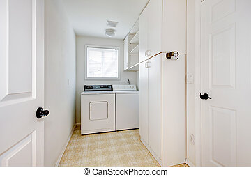 Laundry room with white walls and appliances.
