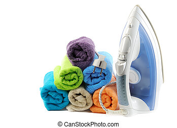 Laundry - Cotton colorful towels and steam iron , closeup