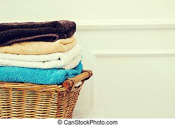 Wicker basket - Laundry. Wicker basket with clean towels