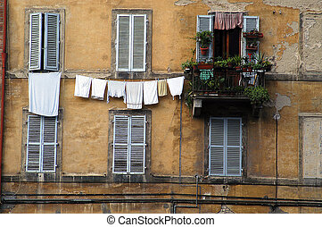 Laundry, windows, Siena, Italy - Laundry hanging from a...