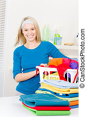 Laundry - woman folding clothes home, housework