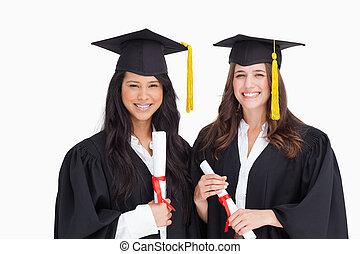 laureandosi, secondo, due, insieme, stare in piedi, amici