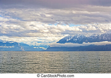 Lausanne quay of Geneva Lake and mountains in Switzerland