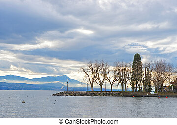 Lausanne quay of Geneva Lake with trees in Switzerland