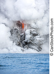 Lava pouring into the ocean in Hawaii - A lava flow on the...