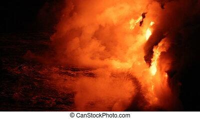 Lava reaching ocean from lava stream on Big Island Hawaii. ...