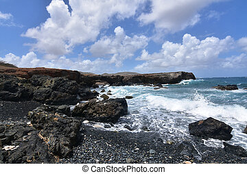 Lava Rocks Lining the Black Stone Beach in Aruba