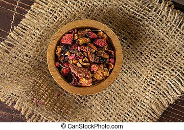 Lavander strawberry tea on brown wood