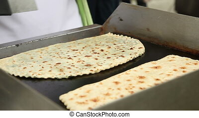 Lavash cooked on the stove. Russian holiday Maslenitsa