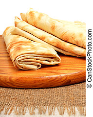 Lavash, tortilla wrap Bread on the cutting board isolated on...